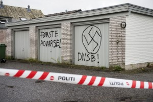 "Swastika signs are seen on the walls of the Red Cross asylum center in Lyngbygaard, in Trustrup, in the west of Denmark August 27, 2015. The asylum center was vandalized by unidentified men, who drew Nazi symbols and wrote a message reading ""first warning"", on Wednesday night. A vehicle was also set on fire outside the center. Police told local media, it was a the third time the asylum center was targeted by vandals with an apparent political motive. REUTERS/ Bo Amstrup/Scanpix Denmark ATTENTION EDITORS - THIS IMAGE WAS PROVIDED BY A THIRD PARTY. FOR EDITORIAL USE ONLY. NOT FOR SALE FOR MARKETING OR ADVERTISING CAMPAIGNS. THIS PICTURE IS DISTRIBUTED EXACTLY AS RECEIVED BY REUTERS, AS A SERVICE TO CLIENTS. DENMARK OUT. NO COMMERCIAL OR EDITORIAL SALES IN DENMARK. NO COMMERCIAL SALES."